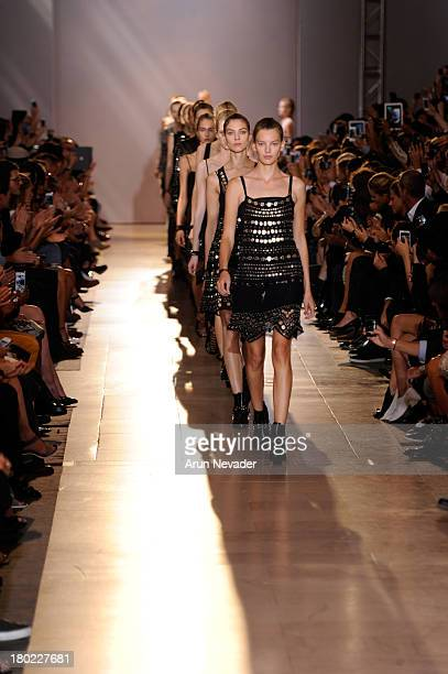 Models walk the runway at the Diesel Black Gold fashion show during MercedesBenz Fashion Week Spring 2014 at Vanderbilt Hall at Grand Central...