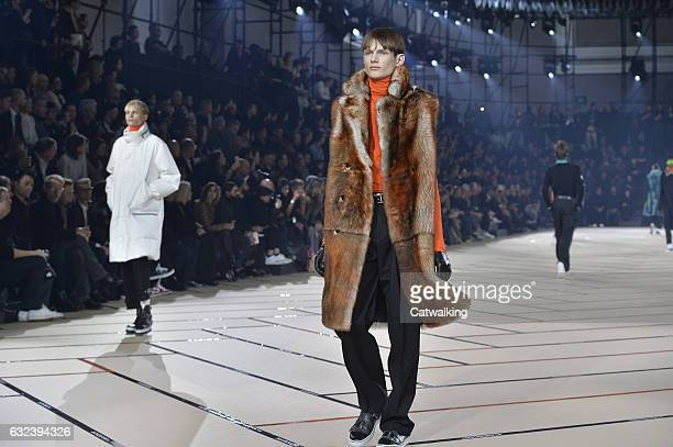 Models walk the runway at the Dior Homme Autumn Winter 2017 fashion show during Paris Menswear Fashion Week on January 21 2017 in Paris France