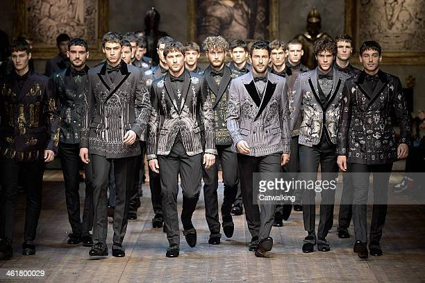 Models walk the runway at the Dolce and Gabbana Autumn Winter 2014 fashion show during Milan Menswear Fashion Week on January 11 2014 in Milan Italy