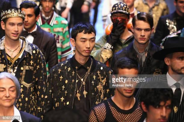 Models walk the runway at the Dolce Gabbana show during Milan Men's Fashion Week Spring/Summer 2019 on June 16 2018 in Milan Italy