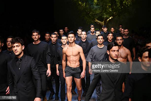 Models walk the runway at the Dolce Gabbana show during Milan Menswear Fashion Week Spring Summer 2014 on June 22 2013 in Milan Italy