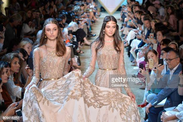 Models walk the runway at the Elie Saab Autumn Winter 2017 fashion show during Paris Haute Couture Fashion Week on July 5, 2017 in Paris, France.