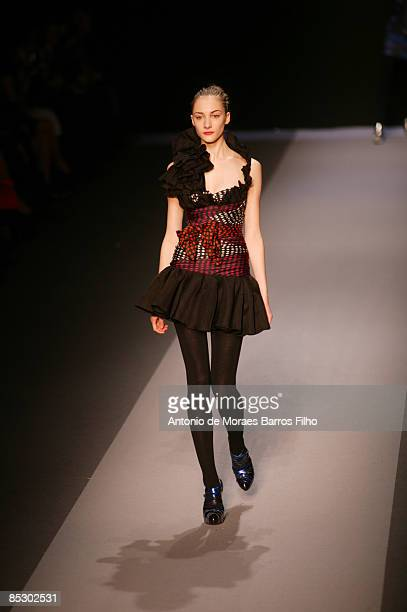 Models walk the runway at the Emanuel Ungaro ReadytoWear A/W 2009 fashion show during Paris Fashion Week at Le Carrousel du Louvre on March 8 2009 in...