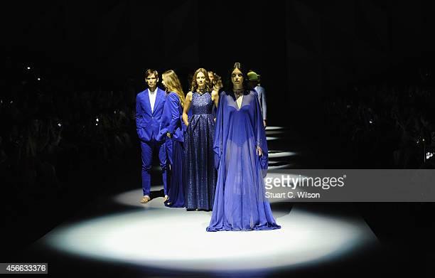 Models walk the runway at The Emperor 1688 show during Fashion Forward at Madinat Jumeirah on October 4 2014 in Dubai United Arab Emirates