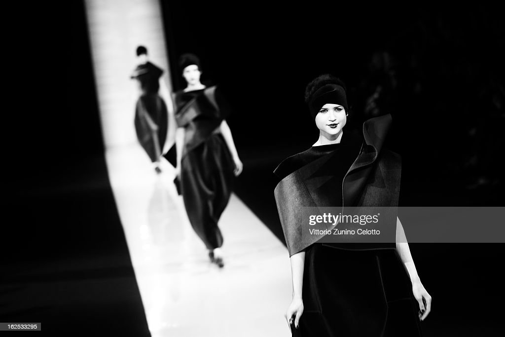 Models walk the runway at the Emporio Armani fashion show as part of Milan Fashion Week Womenswear Fall/Winter 2013/14 on February 24, 2013 in Milan, Italy.