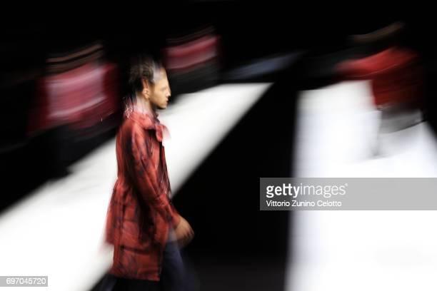 Models walk the runway at the Emporio Armani fashion show during Milan Men's Fashion Week Spring/Summer 2018on June 17 2017 in Milan Italy
