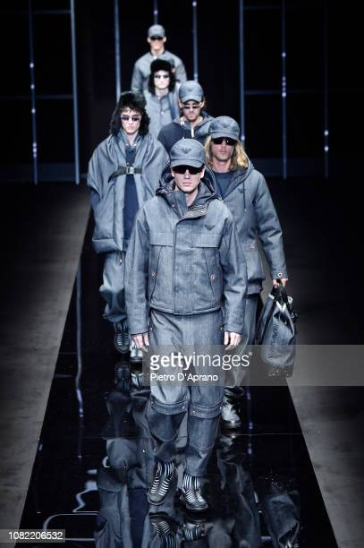 Models walk the runway at the Emporio Armani show during Milan Menswear Fashion Week Autumn/Winter 2019/20 on January 14 2019 in Milan Italy