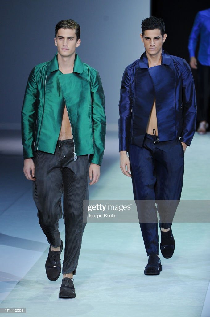 Models walk the runway at the Emporio Armani show during Milan Menswear Fashion Week Spring Summer 2014 show on June 24, 2013 in Milan, Italy.