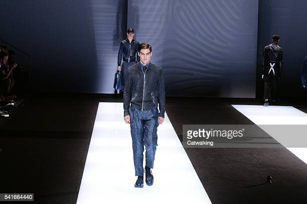 Models walk the runway at the Emporio Armani Spring Summer 2017 fashion show during Milan Menswear Fashion Week on June 20, 2016 in Milan, Italy.