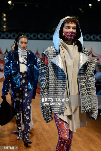 Models walk the runway at the Emre Pakel show during MercedesBenz Istanbul Fashion Week at the Zorlu Performance Hall on March 19 2019 in Istanbul...