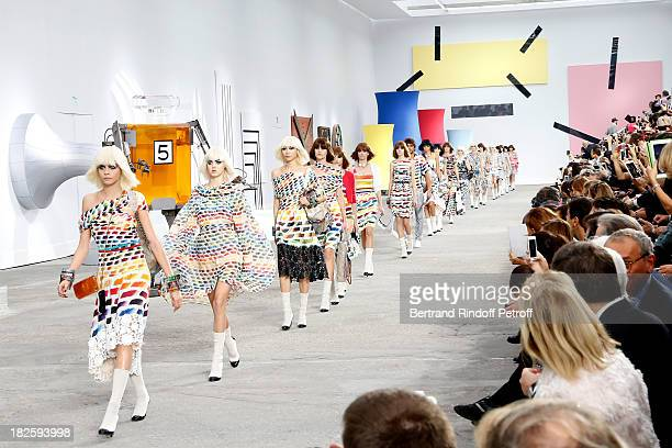 Models walk the runway at the end of Chanel show as part of the Paris Fashion Week Womenswear Spring/Summer 2014 held at Grand Palais on October 1...