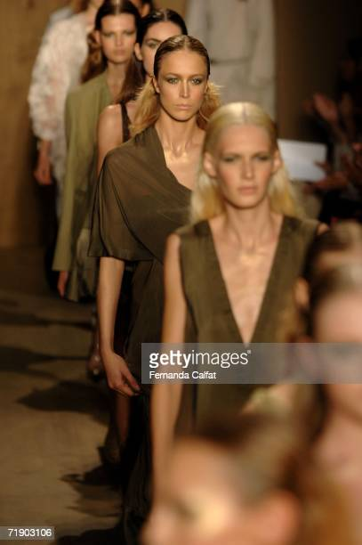 Models walk the runway at the end of the Donna Karan Spring 2007 Fashion show during Olympus Fashion Week September 15 2006 in New York City