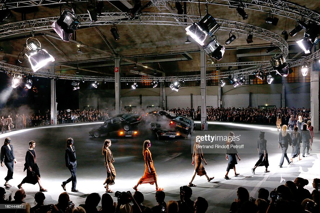 Models walk the runway at the end of the Givenchy show as part of the Paris Fashion Week Womenswear Spring/Summer 2014, held at 'la Halle Freyssinet' on September 29, 2013 in Paris, France.