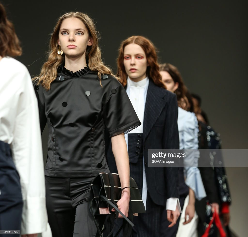 Models walk the runway at the Eudon Choi Show during London Fashion Week February 2018 at BFC Show Space.