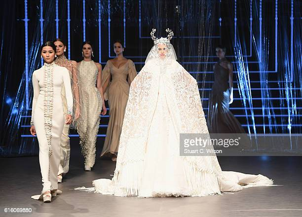 Models walk the runway at the Ezra show during Fashion Forward Spring/Summer 2017 at the Dubai Design District on October 21 2016 in Dubai United...