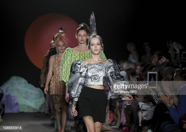 Models walk the runway at the finale of the Ashley Williams presentation during London Fashion Week September 2018 at the House of Vans on September...