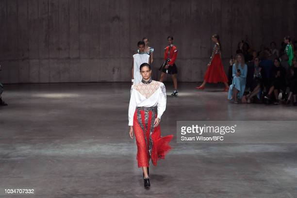 Models walk the runway at the finale of the Christopher Kane show during London Fashion Week September 2018 at Tate Modern on September 17 2018 in...