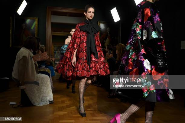 Models walk the runway at the finale of the Erdem show during London Fashion Week February 2019 at the National Portrait Gallery on February 18 2019...