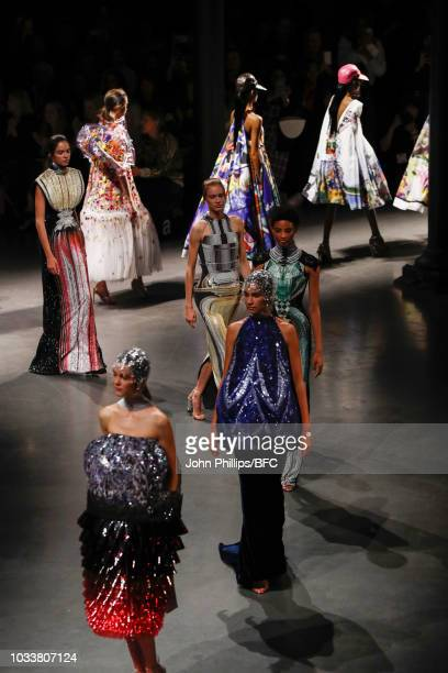 Models walk the runway at the finale of the Mary Katrantzou show during London Fashion Week September 2018 on September 15 2018 in London England