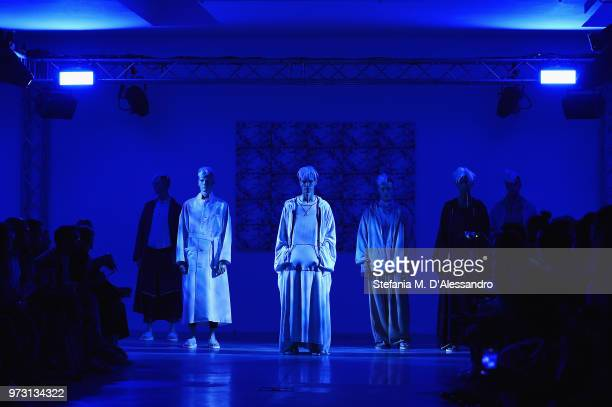 Models walk the runway at the Fumito Ganryu fashion show during the 94th Pitti Immagine Uomo on June 13 2018 in Florence Italy