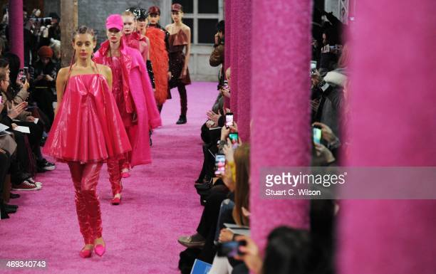 Models walk the runway at the Fyodor Golan show at London Fashion Week AW14 at The Farmiloe Building on February 14 2014 in London England