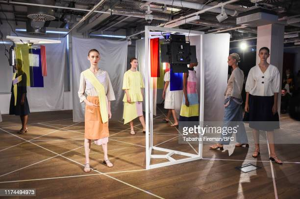 Models walk the runway at the Gayeon Lee show during London Fashion Week September 2019 at Foyles on September 13 2019 in London England