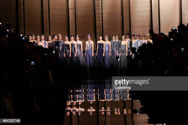 Models walk the runway at the Giorgio Armani Prive Spring Summer 2014 fashion show during Paris Haute Couture Fashion Week on January 21 2014 in...
