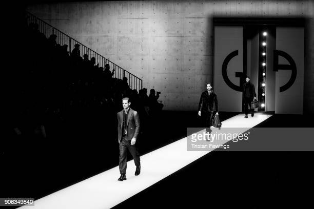 Models walk the runway at the Giorgio Armani show during Milan Men's Fashion Week Fall/Winter 2018/19 on January 15 2018 in Milan Italy