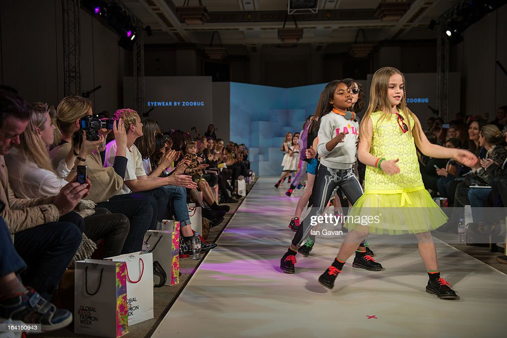 Models walk the runway at the Global Kids Fashion Week SS13 public show in aid of Kids Company at The Freemason's Hall on March 20, 2013 in London, England.
