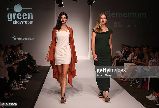 Models walk the runway at the Green Showroom show during the MercedesBenz Fashion Week Berlin Spring/Summer 2017 at Postbahnhof on June 28 2016 in...