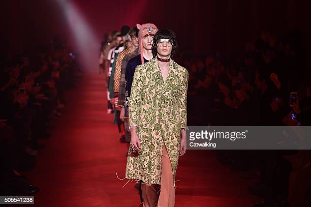 Models walk the runway at the Gucci Autumn Winter 2016 fashion show during Milan Menswear Fashion Week on January 18 2016 in Milan Italy