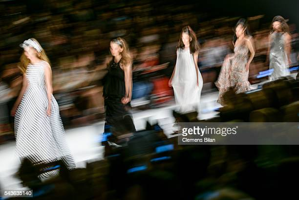 Models walk the runway at the Guido Maria Kretschmer show during the MercedesBenz Fashion Week Berlin Spring/Summer 2017 at Erika Hess Eisstadion on...