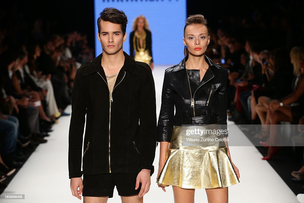 Models walk the runway at the Hakan Akkaya show during Mercedes-Benz Fashion Week Istanbul s/s 2014 presented by American Express on October 9, 2013 in Istanbul, Turkey.