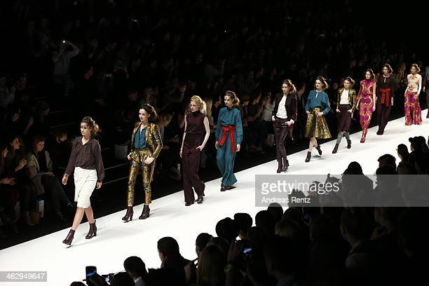 Models walk the runway at the Holy Ghost show during MercedesBenz Fashion Week Autumn/Winter 2014/15 at Brandenburg Gate on January 16 2014 in Berlin...