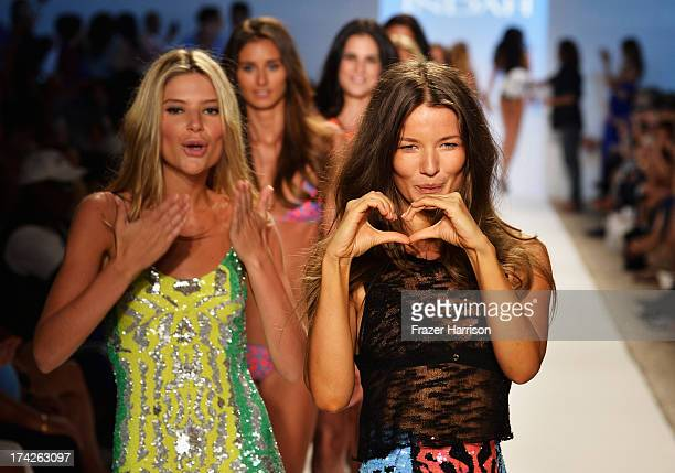 Models walk the runway at the Indah show during MercedesBenz Fashion Week Swim 2014 at Cabana Grande at the Raleigh on July 22 2013 in Miami Florida