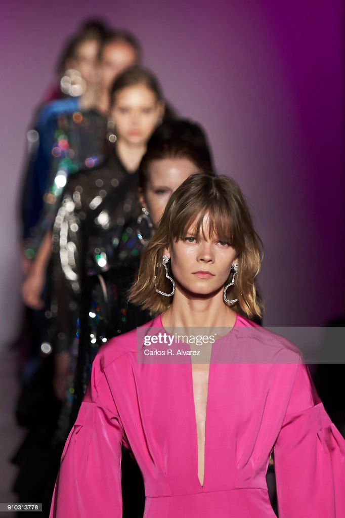 Models walk the runway at the Juan Vidal fashion show during the Mercedes Benz Fashion Week Autumn/Winter 2018 at the Casa de Correos on January 25, 2018 in Madrid, Spain.