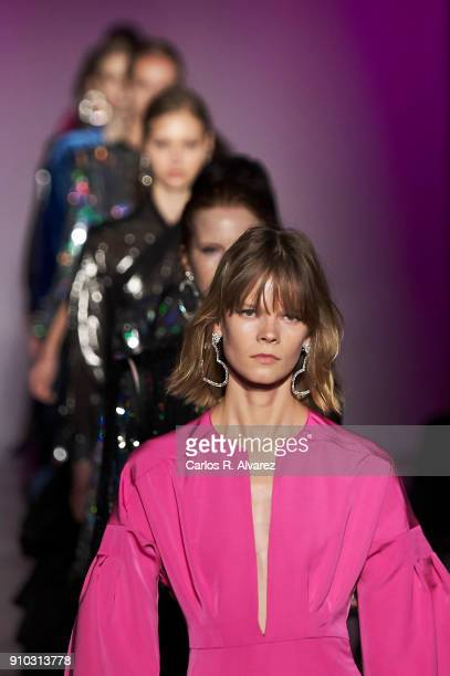 Models walk the runway at the Juan Vidal fashion show during the Mercedes Benz Fashion Week Autumn/Winter 2018 at the Casa de Correos on January 25...
