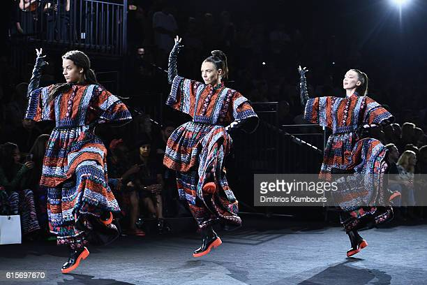 Models walk the runway at the KENZO x HM Launch Event Directed By JeanPaul Goude' at Pier 36 on October 19 2016 in New York City