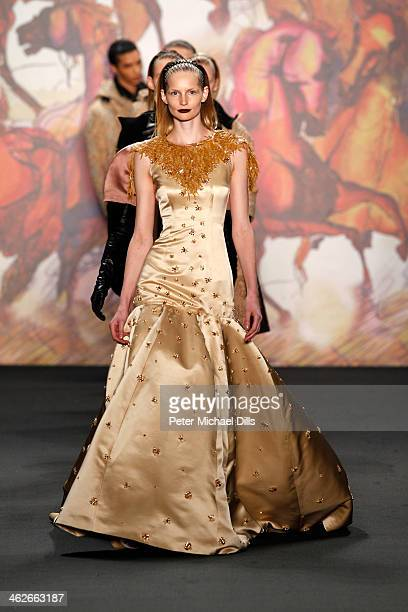 Models walk the runway at the Kilian Kerner show during MercedesBenz Fashion Week Autumn/Winter 2014/15 at Brandenburg Gate on January 14 2014 in...