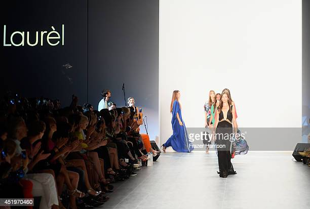 Models walk the runway at the Laurel show during the MercedesBenz Fashion Week Spring/Summer 2015 at Erika Hess Eisstadion on July 10 2014 in Berlin...