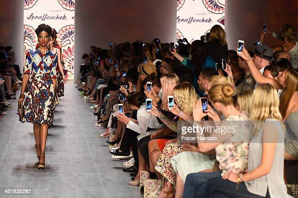 Models walk the runway at the Lena Hoschek show during the Mercedes-Benz Fashion Week Spring/Summer 2015 at Erika Hess Eisstadion on July 8, 2014 in...