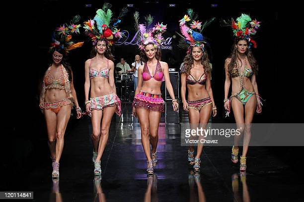 Models walk the runway at the Leonisa fashion show on the third day of Colombiamoda 2011 at Museo De Arte Moderno de Medellin on July 27, 2011 in...
