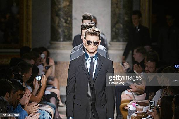 Models walk the runway at the Les Hommes Spring Summer 2015 fashion show during Milan Menswear Fashion Week on June 21, 2014 in Milan, Italy.
