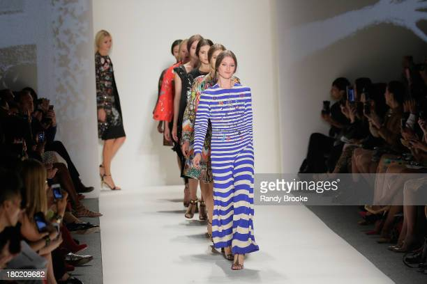 Models walk the runway at the Libertine show during Spring 2014 MercedesBenz Fashion Week at The Studio at Lincoln Center on September 9 2013 in New...