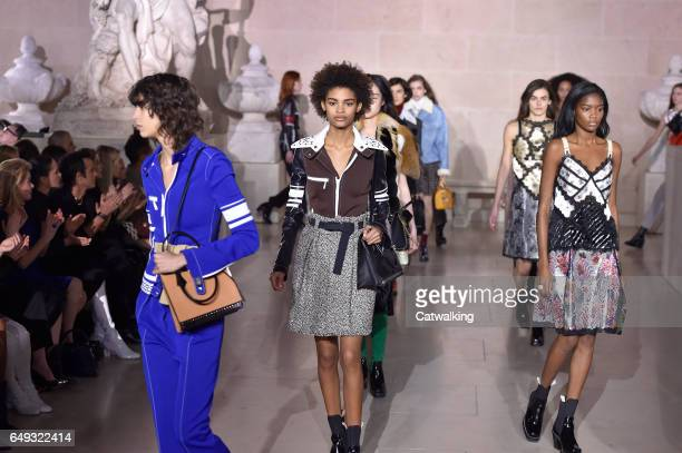Models walk the runway at the Louis Vuitton Autumn Winter 2017 fashion show during Paris Fashion Week on March 7 2017 in Paris France