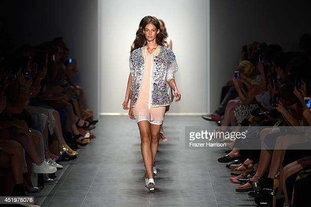 Models walk the runway at the Malaikaraiss show during the MercedesBenz Fashion Week Spring/Summer 2015 at Erika Hess Eisstadion on July 10 2014 in...
