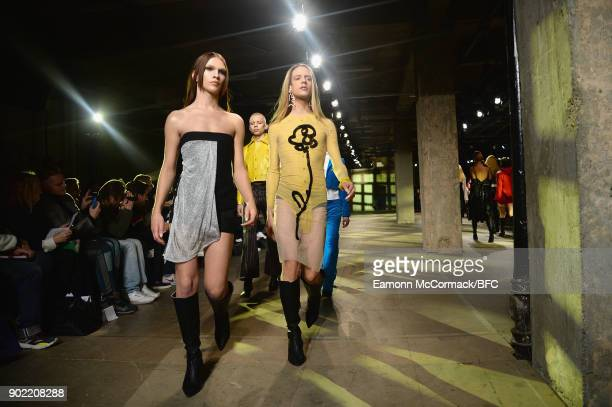 Models walk the runway at the MAN - Art School show during London Fashion Week Men's January 2018 at Old Selfridges Hotel on January 7, 2018 in...