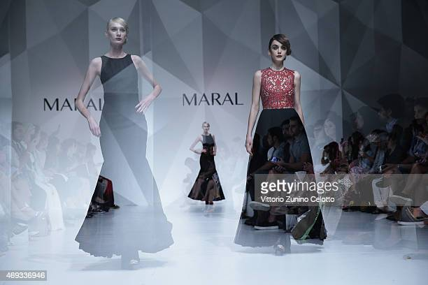 Models walk the runway at the Maral show during Dubai Fashion Forward April 2015 at Madinat Jumeirah on April 11 2015 in Dubai United Arab Emirates