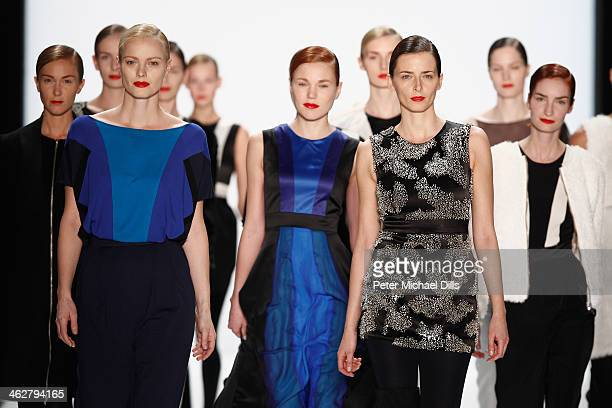 Models walk the runway at the Marcel Ostertag show during MercedesBenz Fashion Week Autumn/Winter 2014/15 at Brandenburg Gate on January 15 2014 in...