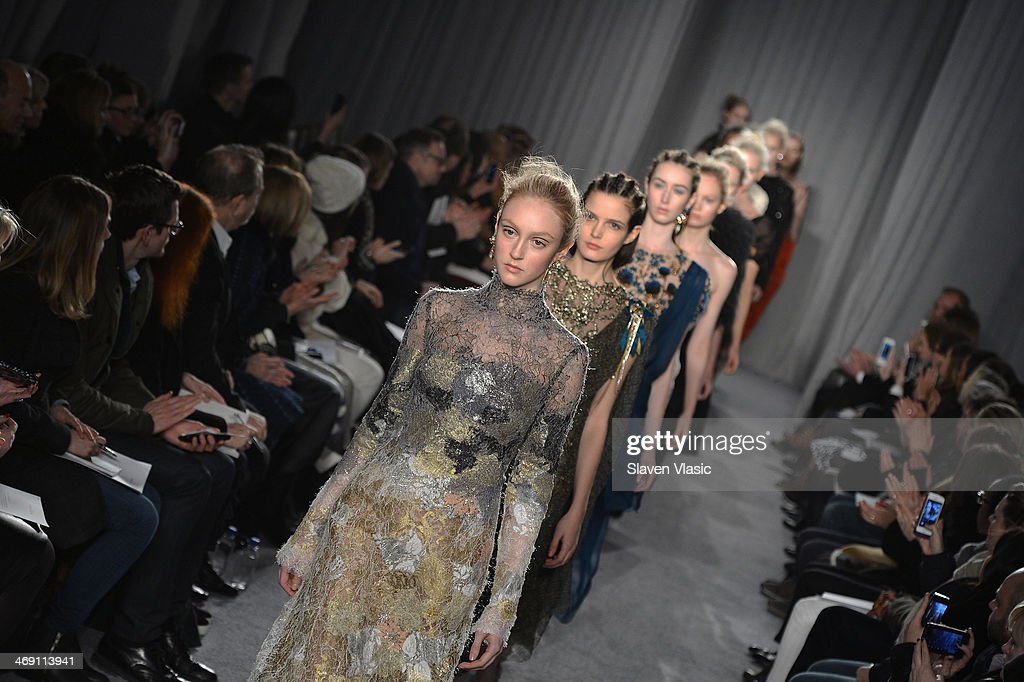 Models walk the runway at the Marchesa fashion show during Mercedes-Benz Fashion Week Fall 2014 at New York Public Library on February 12, 2014 in New York City.